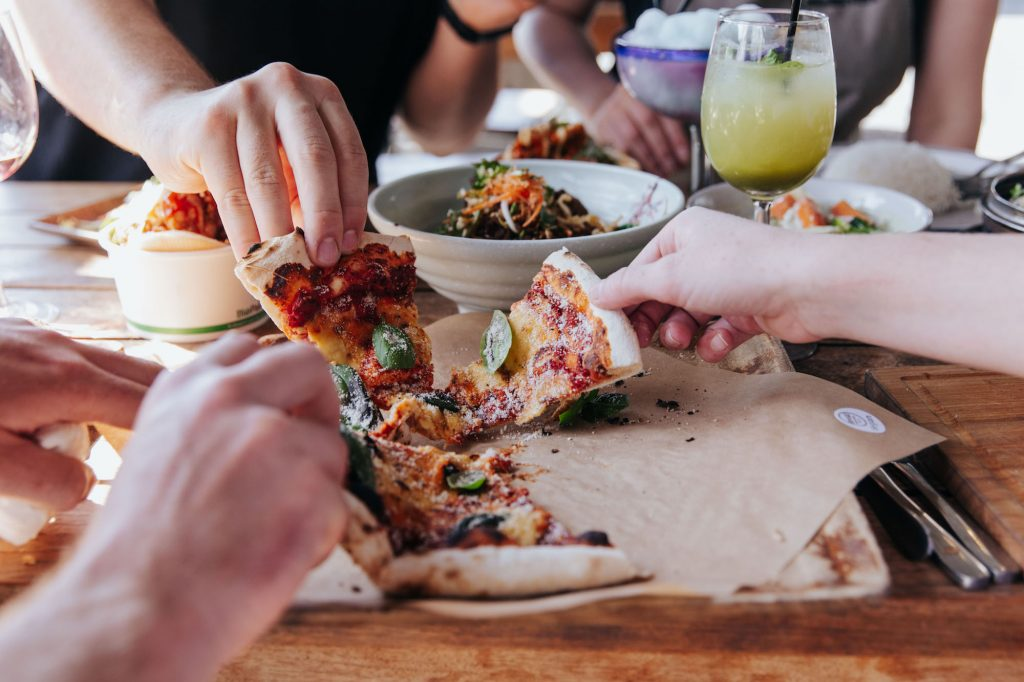 Sharing a pizza at Little High Eatery